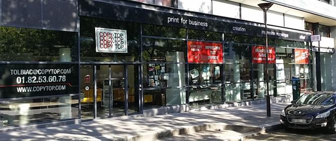 Vitrine imprimeur COPY-TOP Paris | agence Tolbiac Bibliothèque
