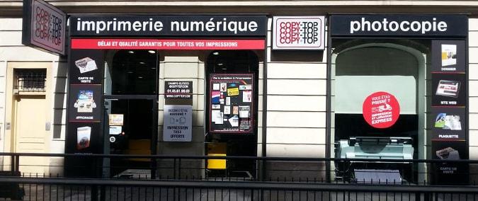 Vitrine imprimeur COPY-TOP Paris | agence Champs-Élysées