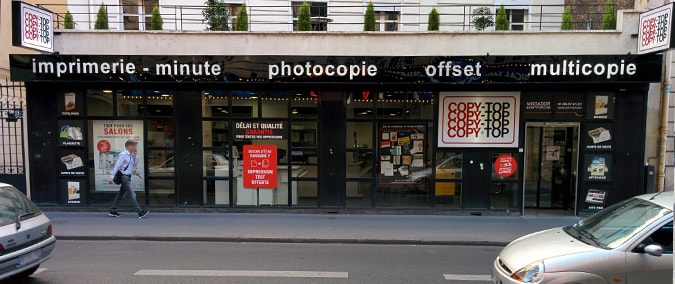 Vitrine imprimeur COPY-TOP Paris | agence Mogador - Trinité