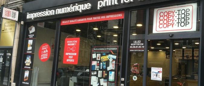 Vitrine imprimeur COPY-TOP Lille | agence Lille Nationale - Liberté