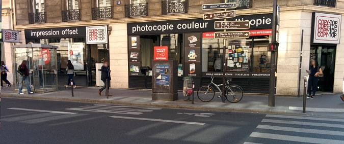 Vitrine imprimeur COPY-TOP Paris | agence Opéra-Bourse