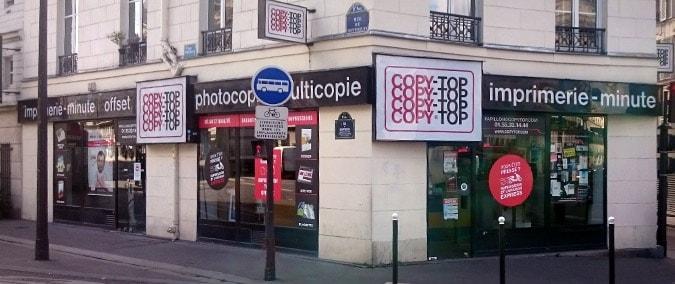 Vitrine imprimeur COPY-TOP Paris | agence Papillon - La Fayette