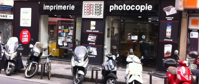Vitrine imprimeur COPY-TOP Paris | agence Bonne-Nouvelle