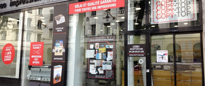 Vitrine imprimeur COPY-TOP LYON | agence Lyon Hôtel de Ville