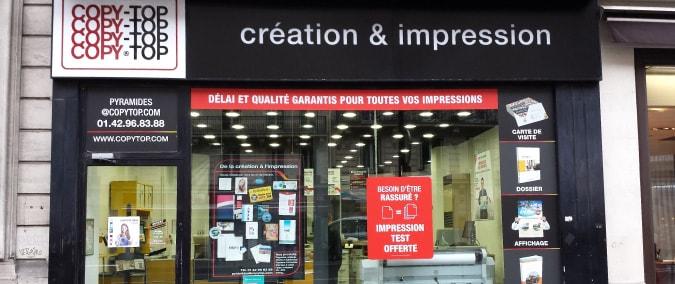 Vitrine imprimeur COPY-TOP Paris | agence Pyramides - Palais Royal