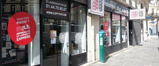 Vitrine imprimeur COPY-TOP Paris | agence Saint-Lazare - Rome